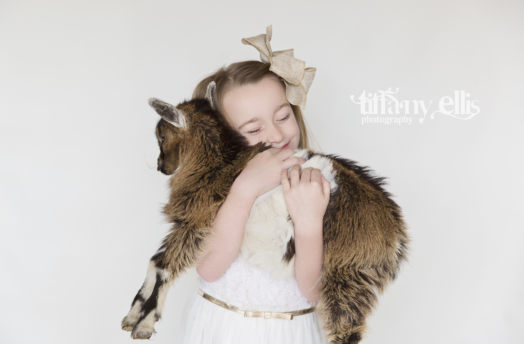 child Easter photography bunny mini session spring rabbit Tiffany Ellis Photography photographer children Camden South Carolina Columbia goat baby goat miniature goat