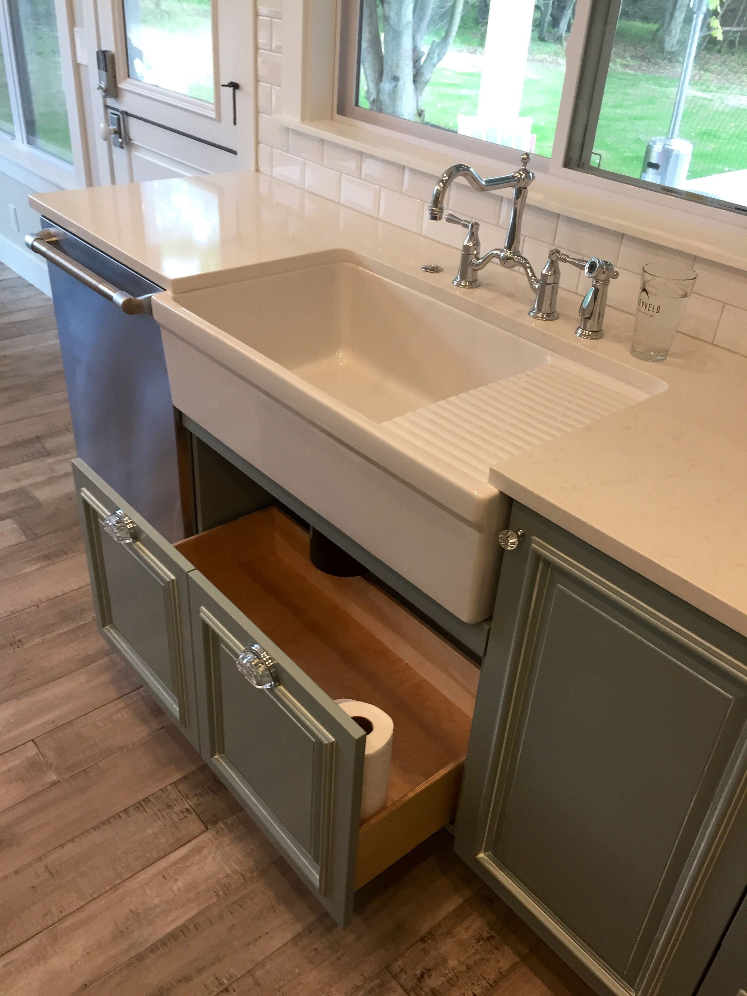 Farmhouse apron front sink featuring a drawer disguised as doors