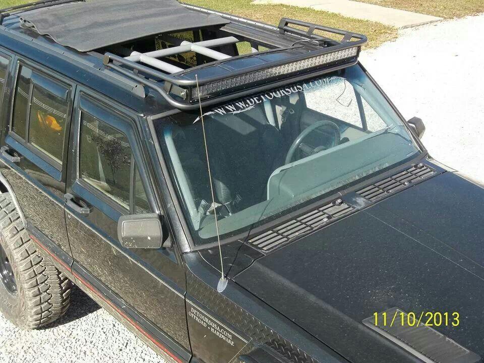Roll Back Sun Roof With An Awesome Light Bar Jeep Zj Custom Jeep Jeep