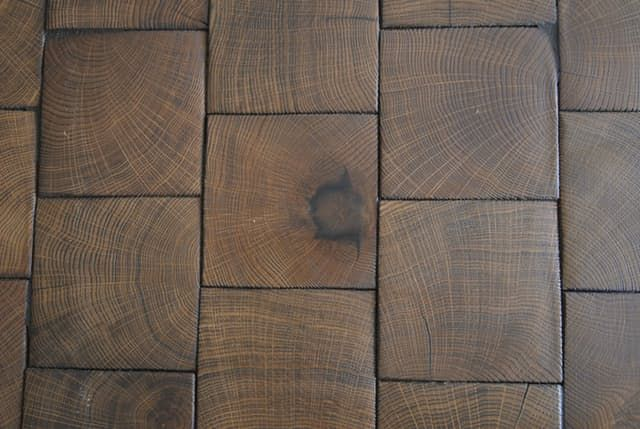 When you look at pictures of interiors all day, you get used to seeing the same things over and over — so it's nice to run across something that is completely new. Except that the technique used to create this end grain block floor, with its beautiful, solid, highly textured appearance, is actually hundreds of years old.