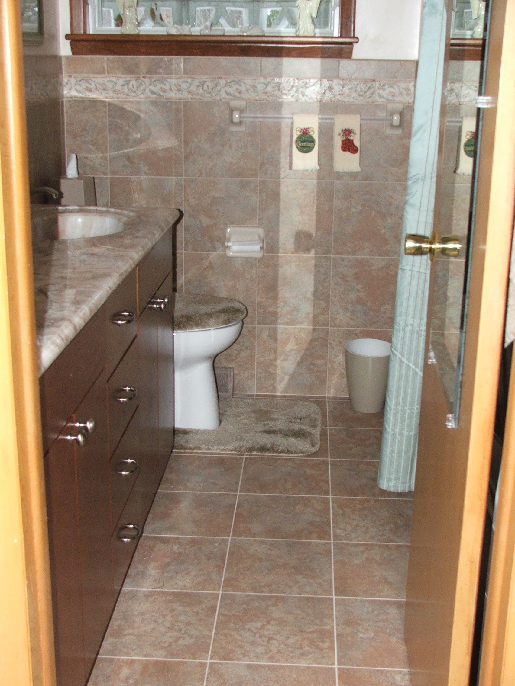 A completely tiled bathroom by custom home interiors in charlotte this soft and beautiful mannington porcelain tile is easy to clean and offers a breathtaking beauty to this updated bathroom dailygadgetfo Image collections