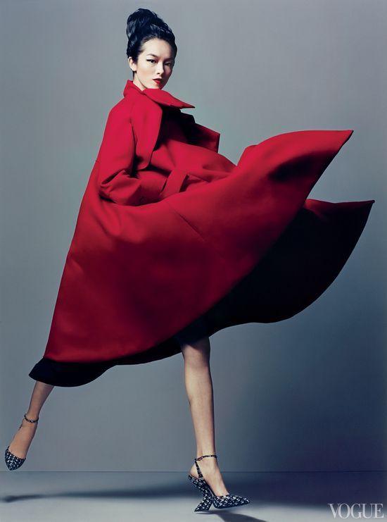 Fei Fei Sun wearing a Dior double-serge wool coat & snakeskin heels