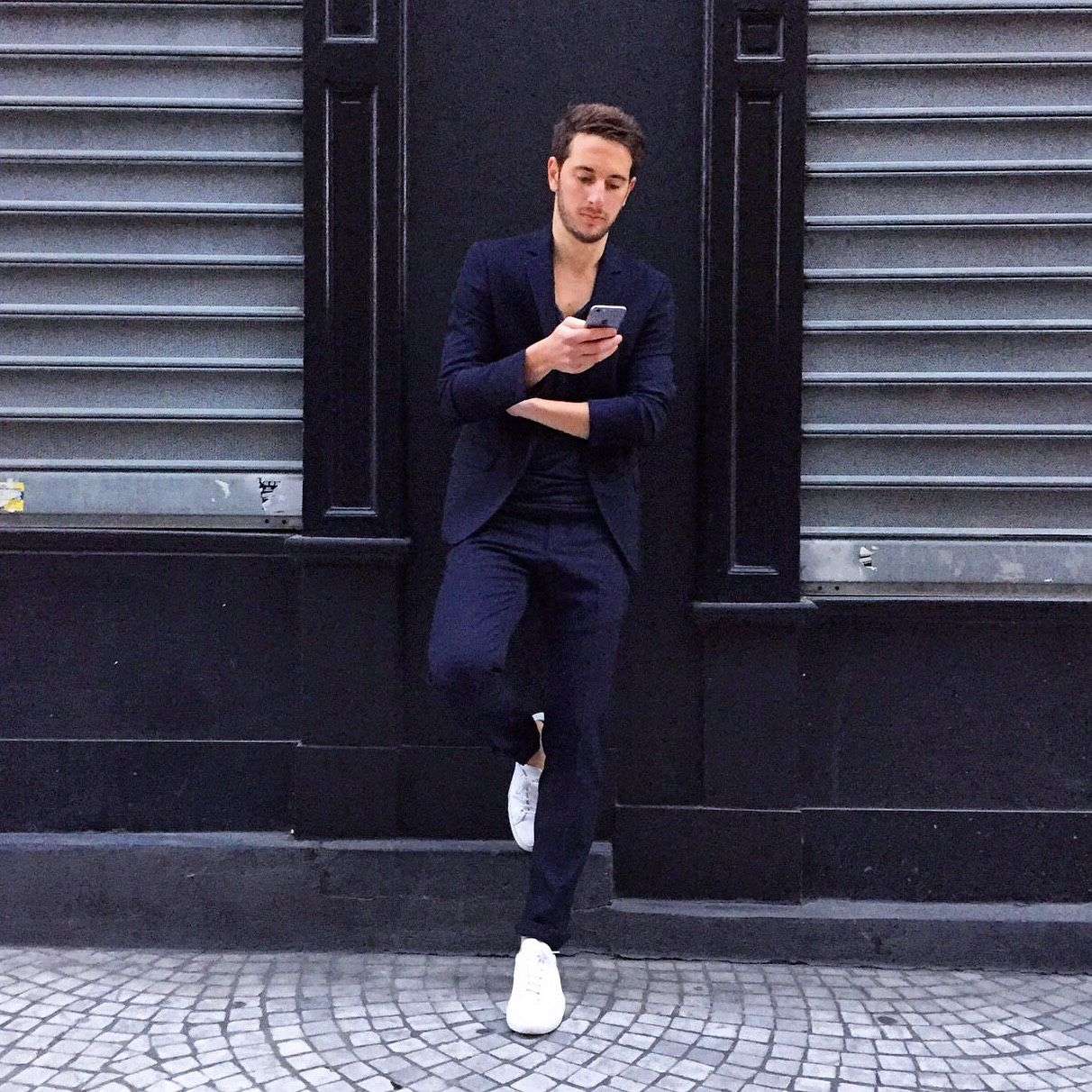 Navy suit and white sneakers Navy suit Karl Lagerfeld, blue tshirt Acne Studios, white sneakers Common Projects