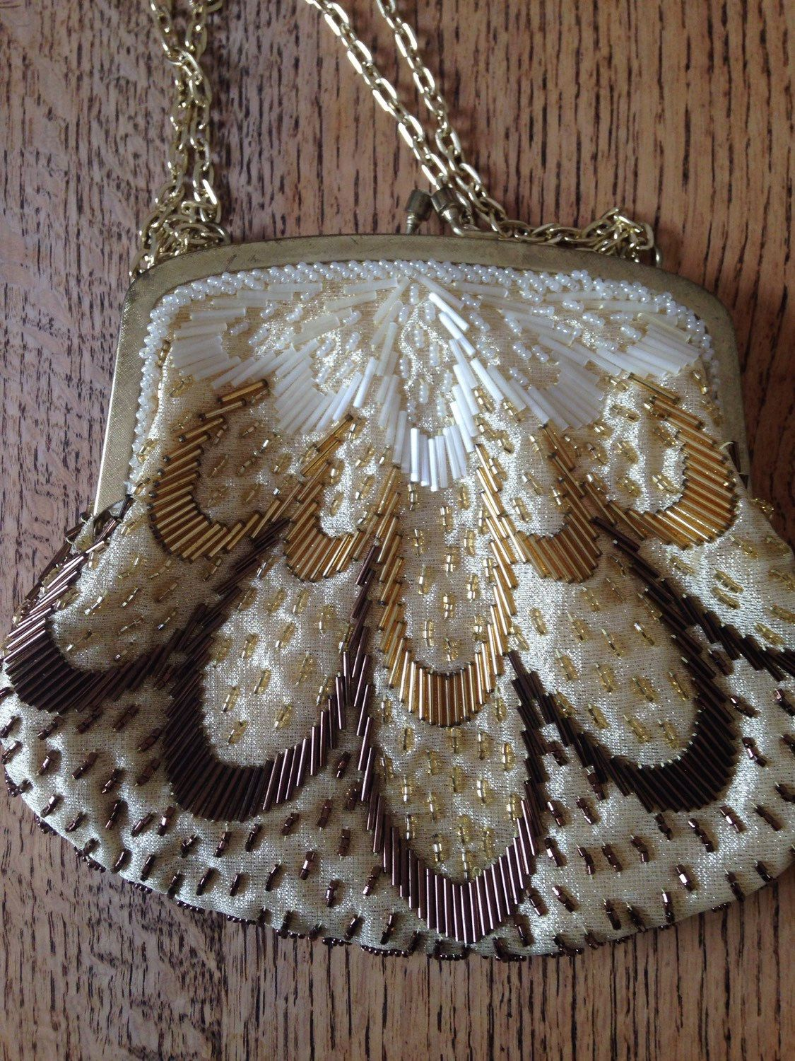 A personal favourite from my Etsy shop https://www.etsy.com/uk/listing/289506343/vintage-beaded-cream-and-gold-evening
