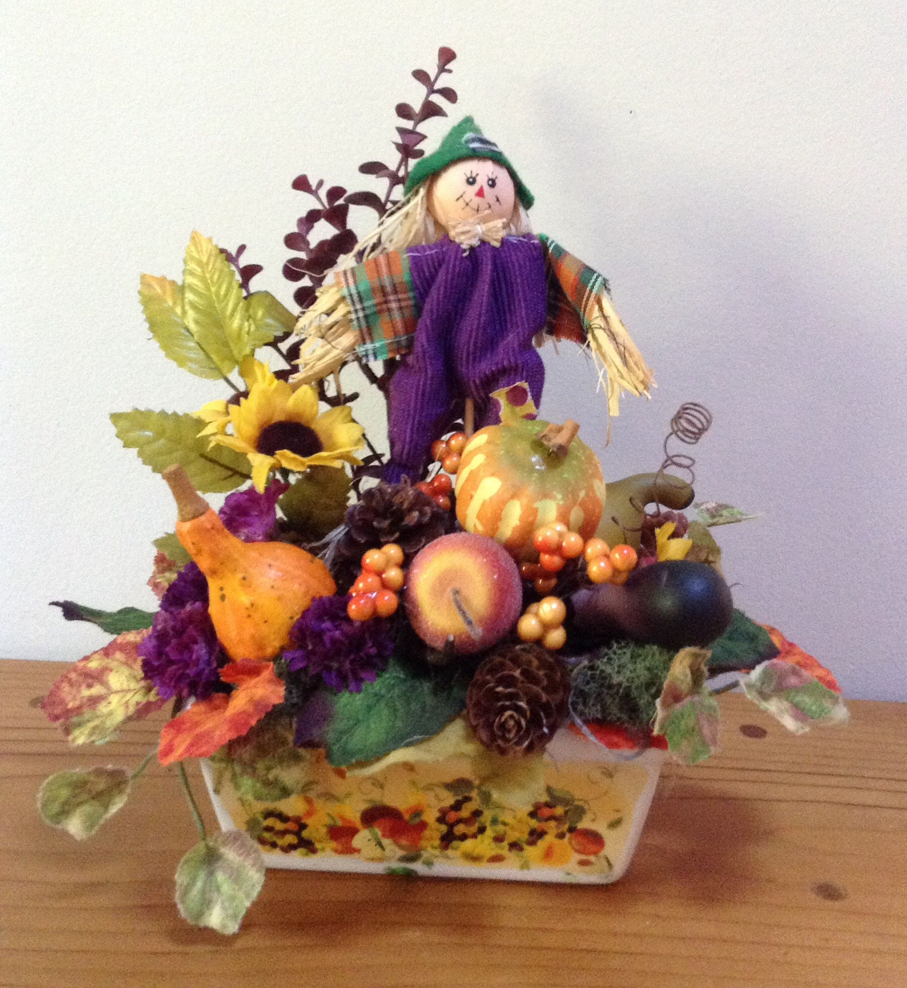 Fall arrangement with scarecrow