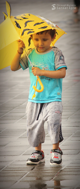 Kid enjoying rains..!!