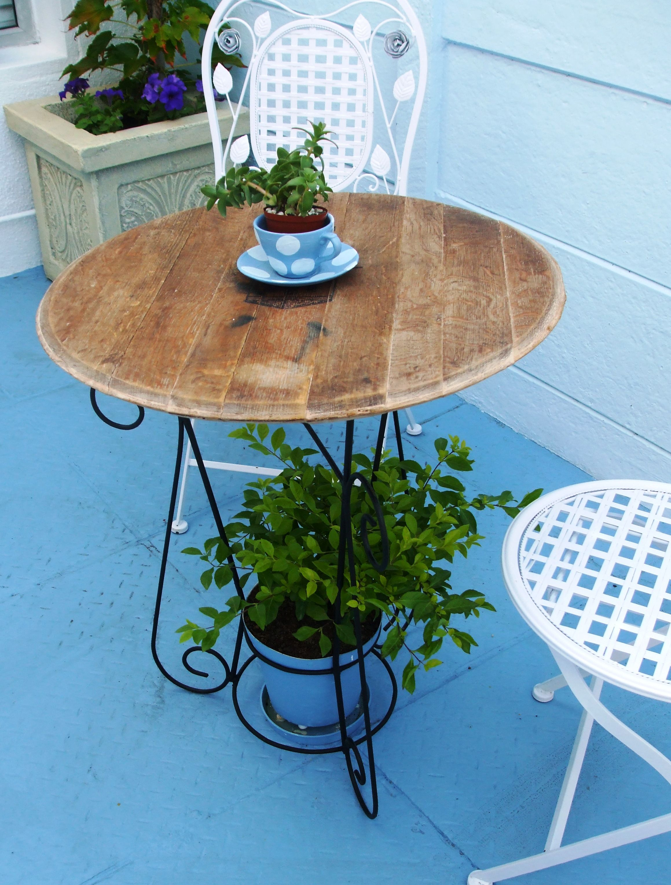 Wine barrel lid and old wrought iron pot plant stand, make an ideal ...
