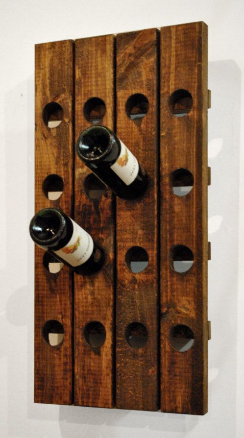 You could use old pallets to make this. Wine Rack - Pottery Barn Crate & Barrel Style. $49.99, via Etsy.