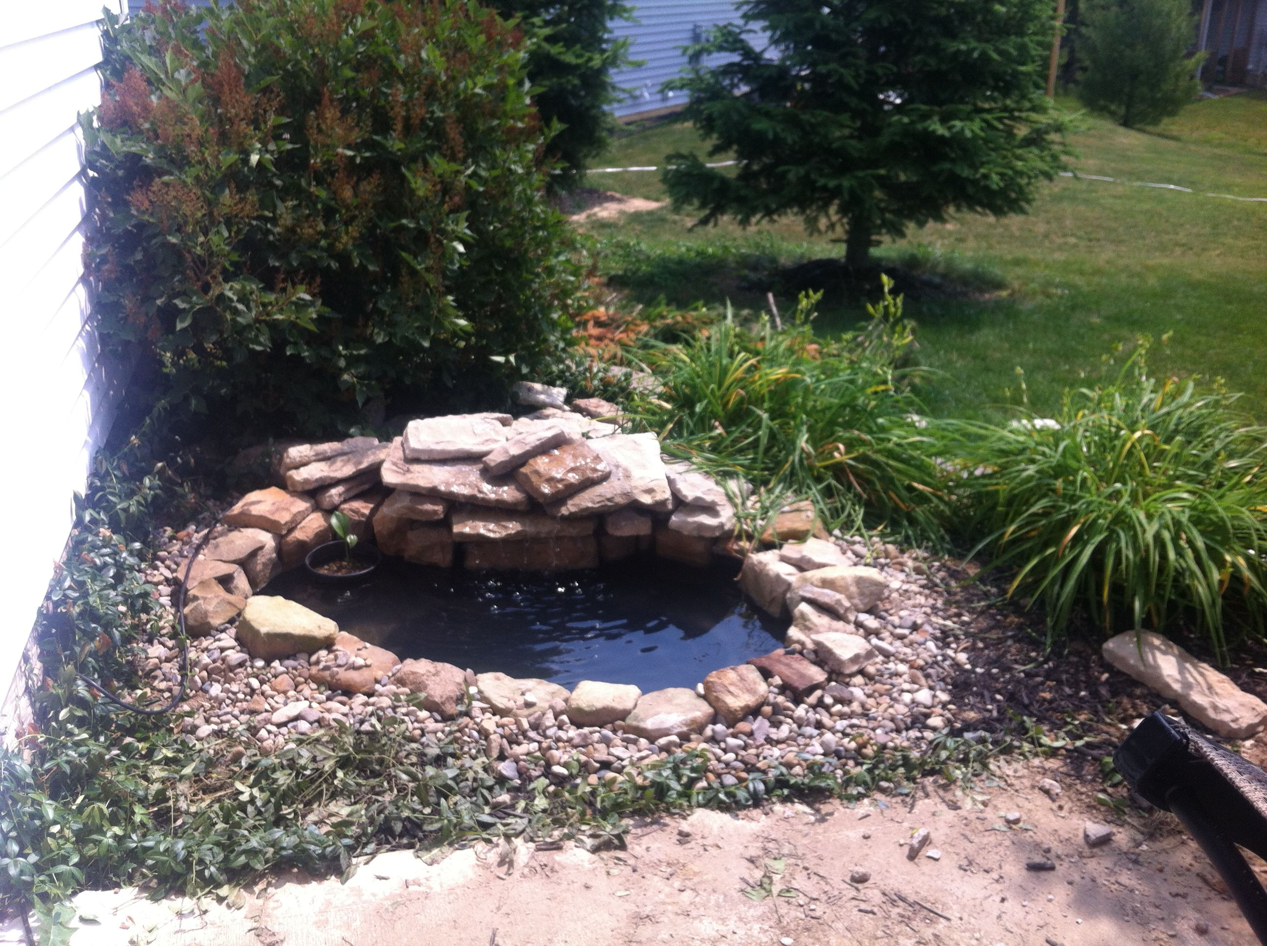 Pond idea get a liner from home depot or lowes 60 find for Stone koi pond