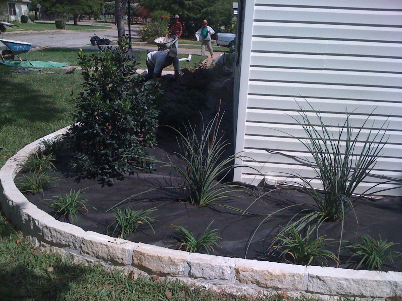 Groundscape a fort worth landscape company installs for Flower bed edging stone