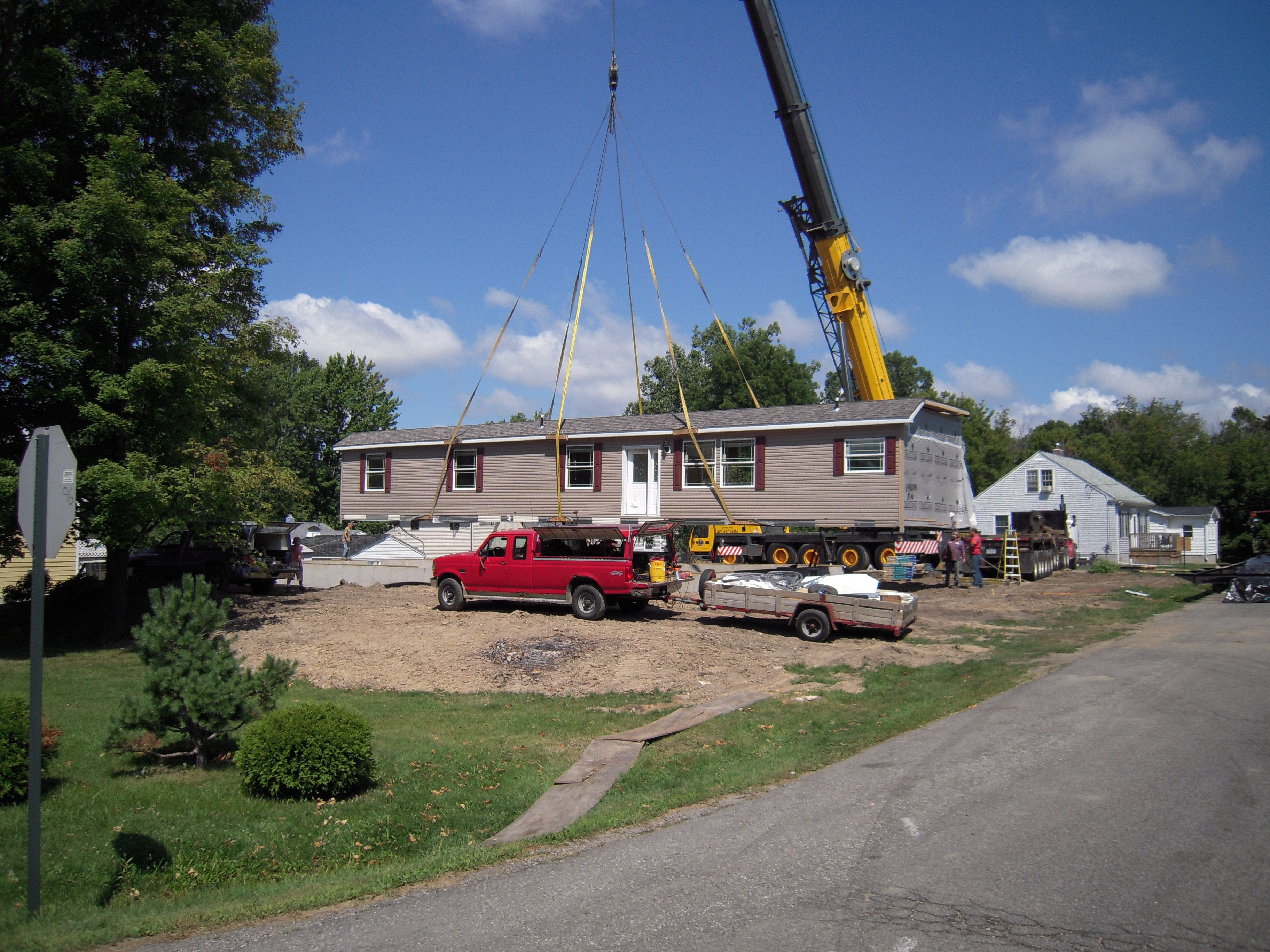Here's a crane set of a long, sidewall modular home with a roof pitch. The  modules don't get any heavier than this one. We built this home in Holt, MI.