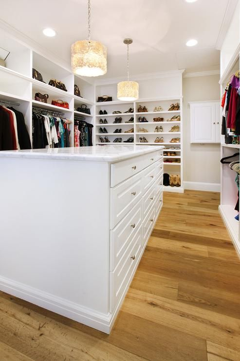 Large Walk In Closet Boasts A Long White Island Fitted