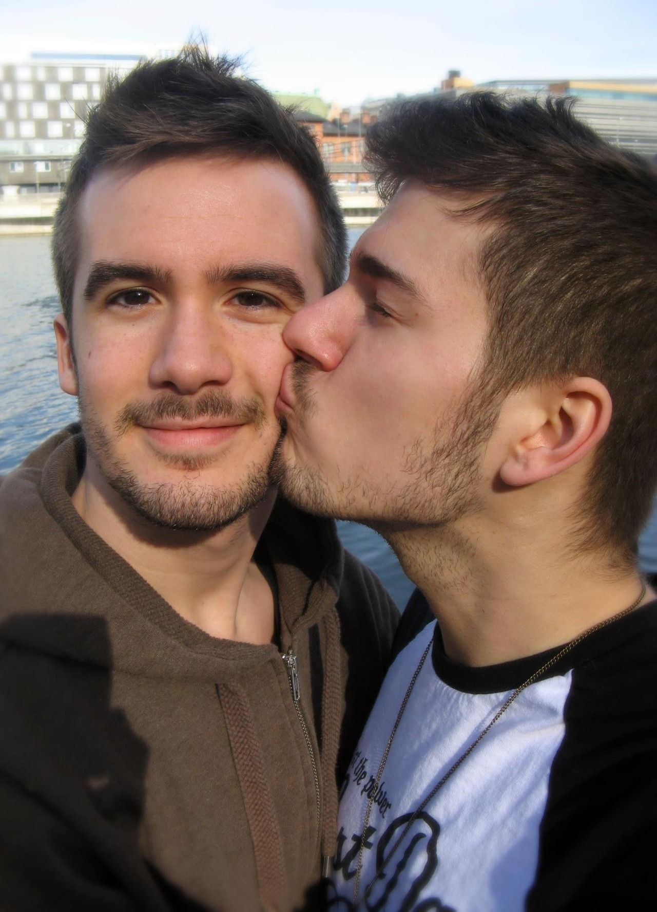 Males kiss and engulf passionately