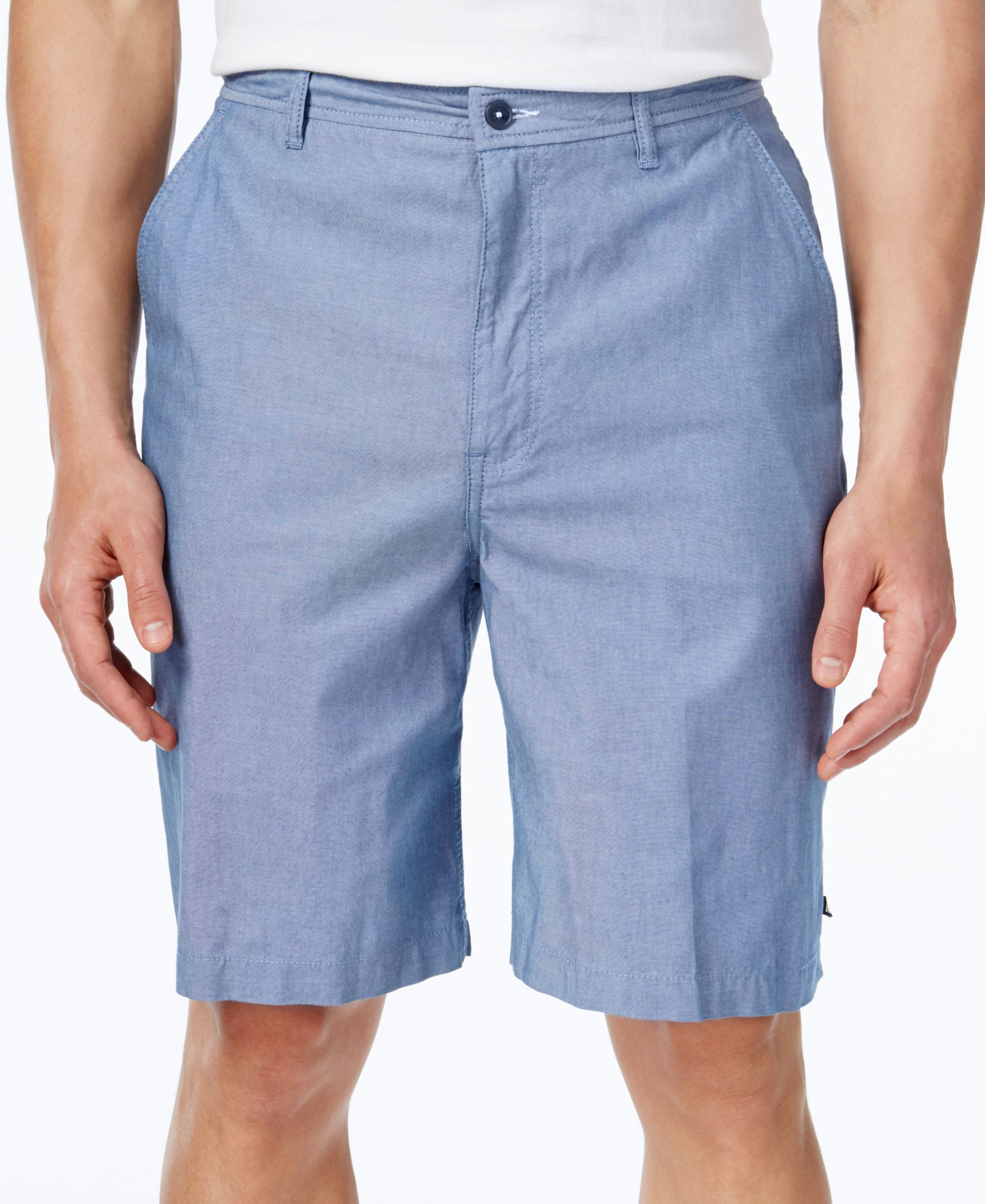Flat-front styling and a comfortable, classic fit finishes these chambray shorts from Geoffrey Beene and your casual, warm-weather look.   Cotton   Machine washable   Imported   Classic fit    Zip fly
