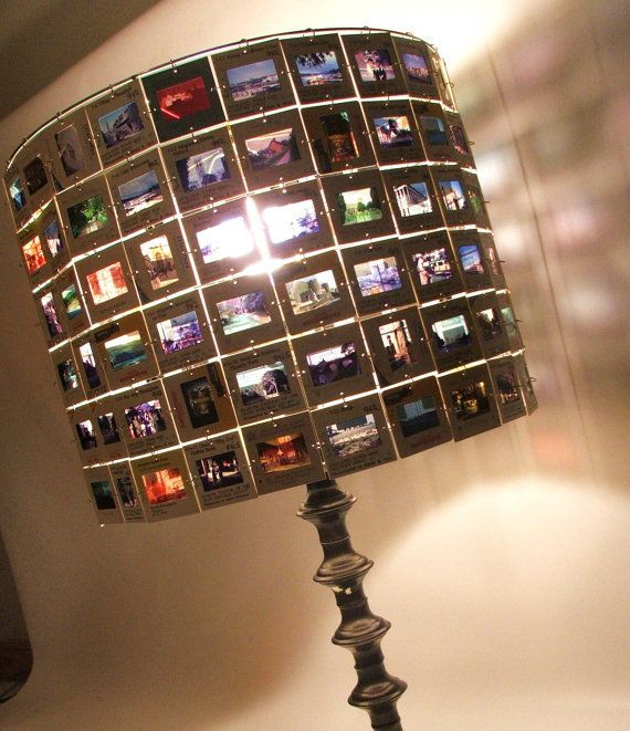 Lamp Shade made from Vintage 35mm Slides - all you need is the top metal rim from old lamp shade(removed), small hole puncher and loop rings.  Very cool idea!