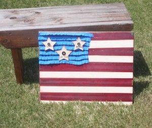 wood ruffles crafting 4th of july     Stars and Stripes  Using a canvas print that she didn't like, she drew the stripes and added ruffled fabric and wooden stars with buttons.  She burned the words into the wooden stars using a burning tool  Sweet!
