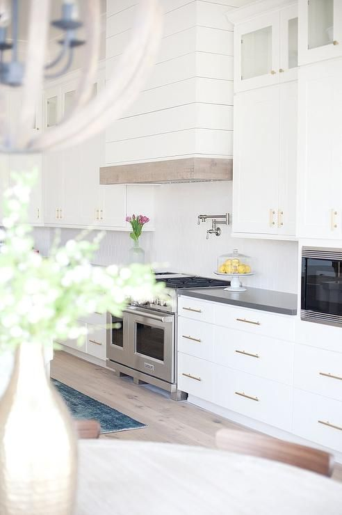 Exquisite Kitchen Features A White Shiplap Range Hood
