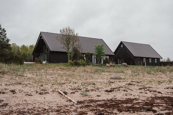 Photo 1 of 14 in A Baltic Sea Beach House Mimics the Extreme Light…
