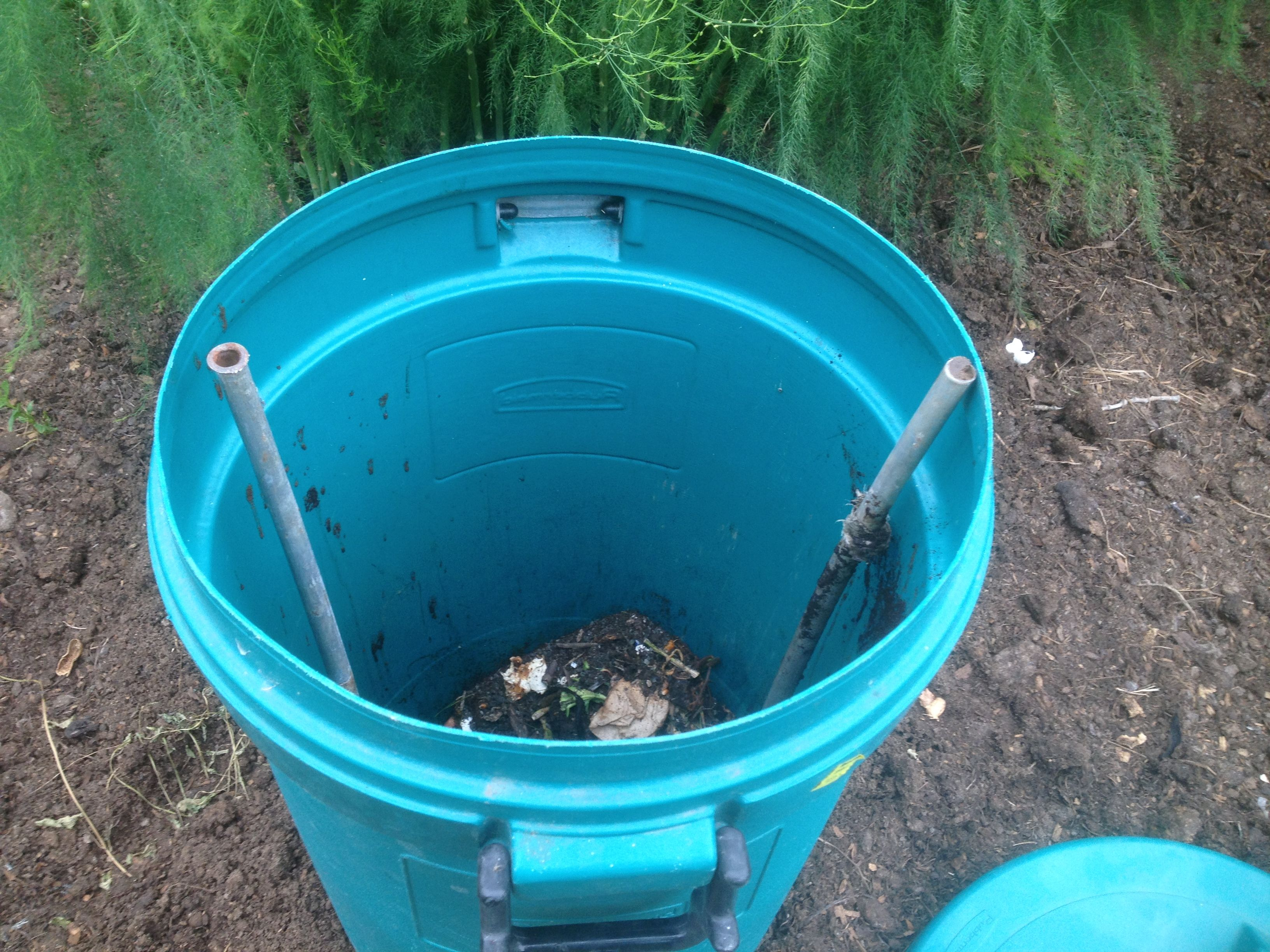 Trash can is bottomless, buried a few inches in the ground next to ...