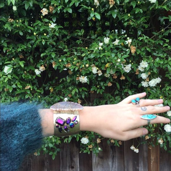 Nasty gal geode and rhinestone brass cuff Big cuff bracelet from nasty gal features a thin geode slice loosely wire wrapped beside a cluster of iridescent purple rhinestones. Brass cuff has a hammered look.  Definitely a unique piece! Nasty Gal Jewelry Bracelets