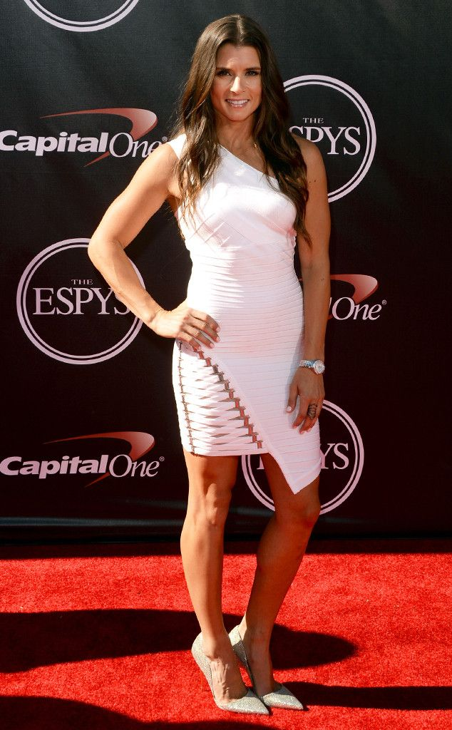 Danica Patrick shows off her fit figure in this sexy white number.