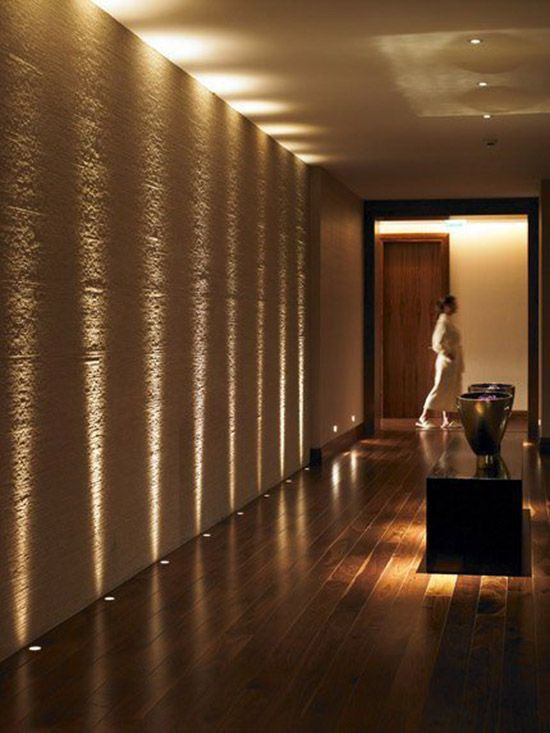 Textured wall becomes dramatic with a series of up lights