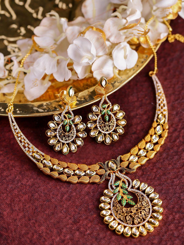 Dhruvi by zaveri pearls green u goldtoned floral kundan u cubic
