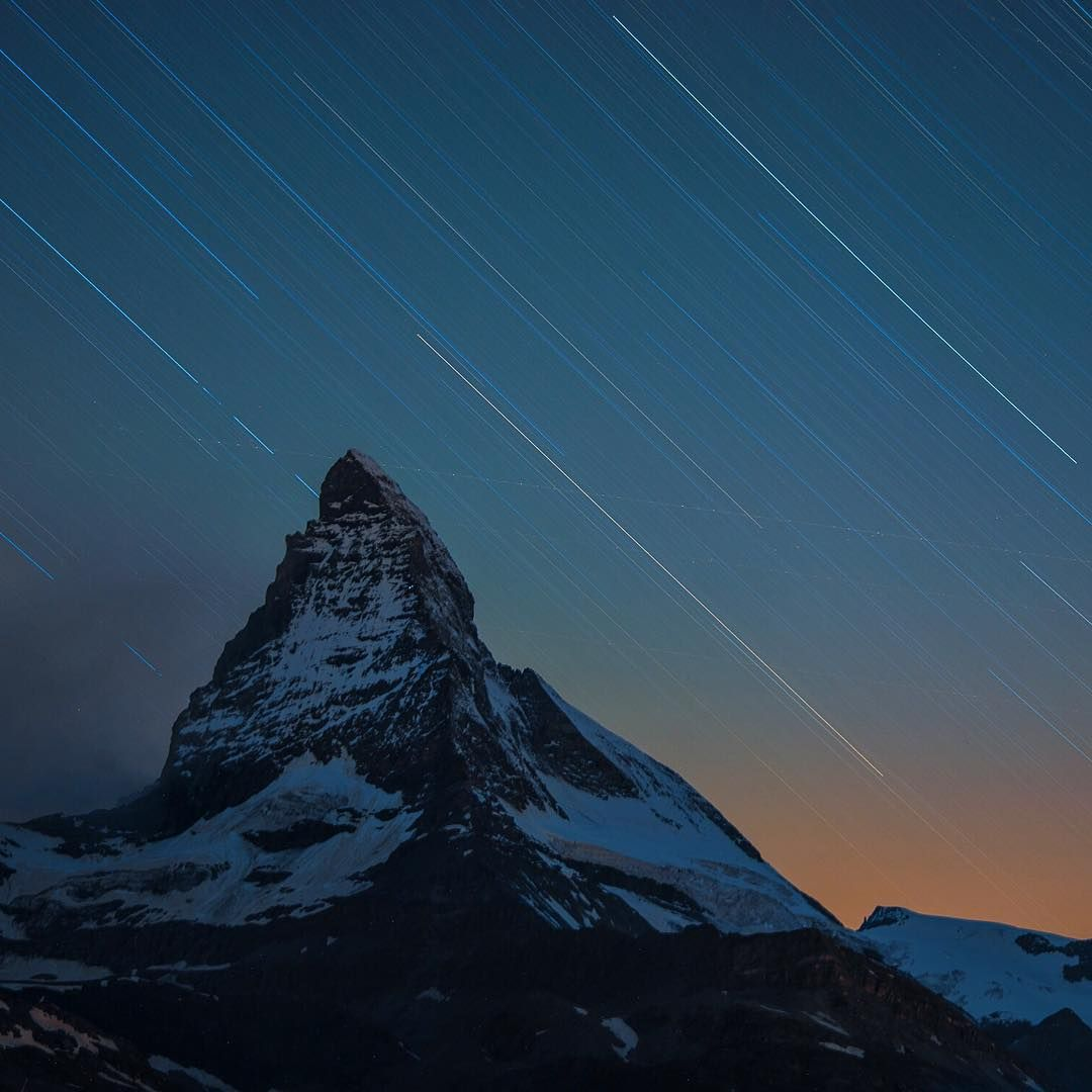 Photo @ladzinski / Stars streaking across the sky taken during a long exposure from twilight into the late hours of the night over the iconic #Matterhorn in Zermatt Switzerland.  #NatGeoStudentExpedition