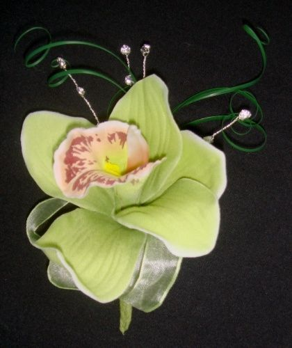 Lime Orchid Corsage @ £12.95    A lime green orchid with a sprinkle of wine to the tongue, complimented by curled grasses and spray diamantes  Inc pin to fasten  www.bridalstudios.co.uk