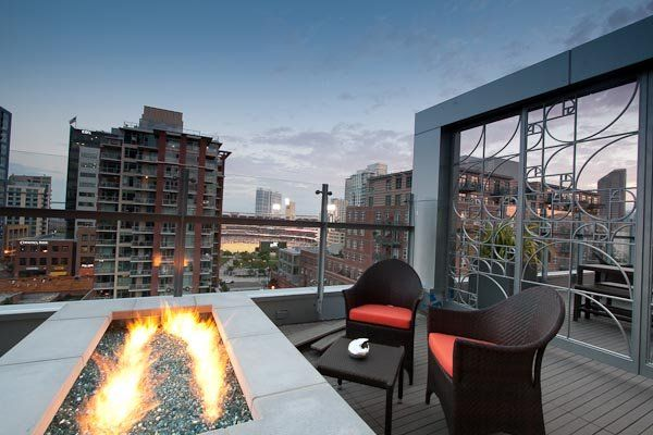 keeping warm by a fire pit atop the hotel indigo while. Black Bedroom Furniture Sets. Home Design Ideas