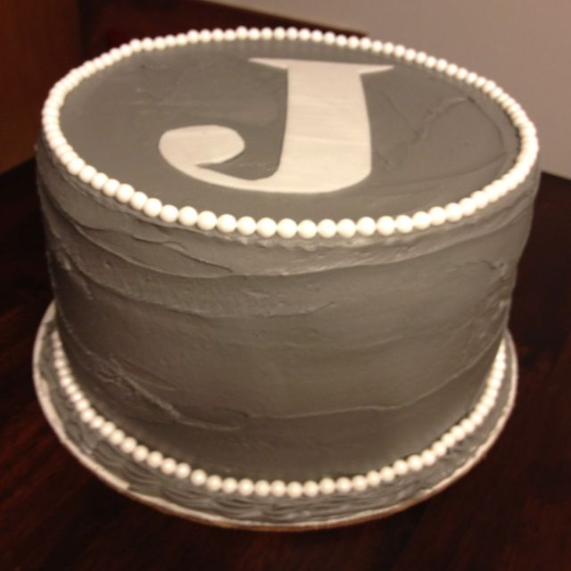 3 layer chocolate, marble, and white cake with gray icing and pearls