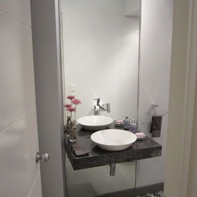 Floor To Ceiling Mirror Behind Small Sink In Gray Powder Room