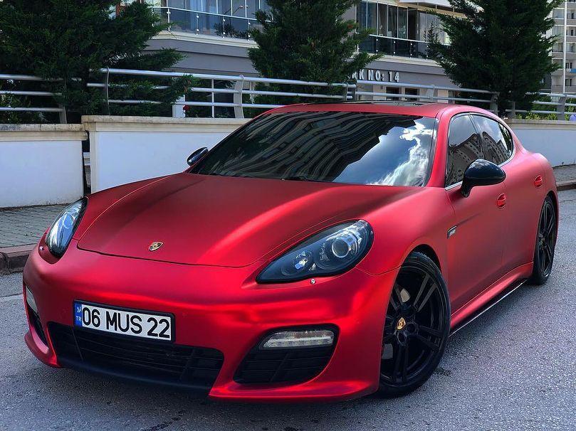 Porsche Panamera wrapped to Satin Red Chrome Black wheels