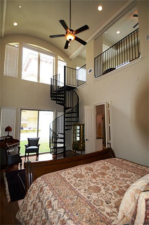 Best Spiral Staircase Leads To Huge Private Retreat In Master 400 x 300