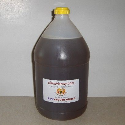 Raw Clover Honey in a 1 gallon container. This is 12 ...