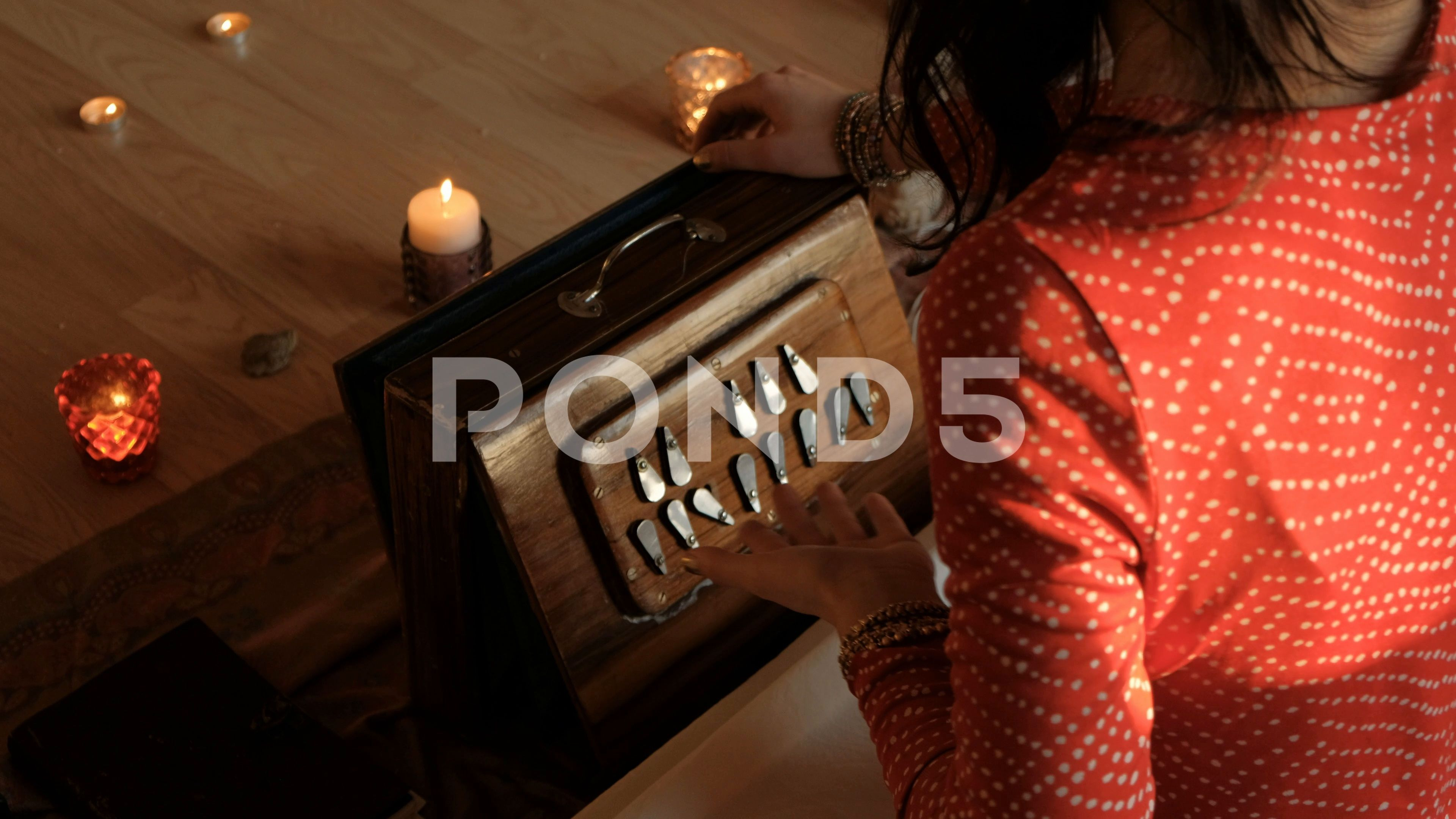 Woman playing old Indian shruti box and singing infront of meditating people Stock Footage shrutiboxIndianWoman