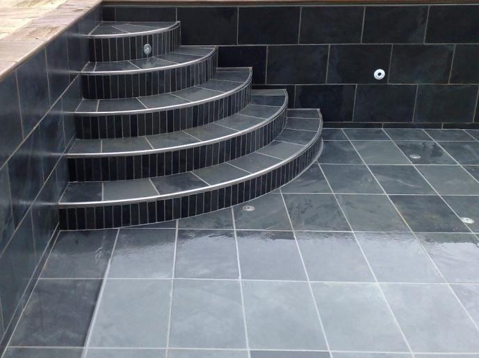 black tiled swimming pool black tile