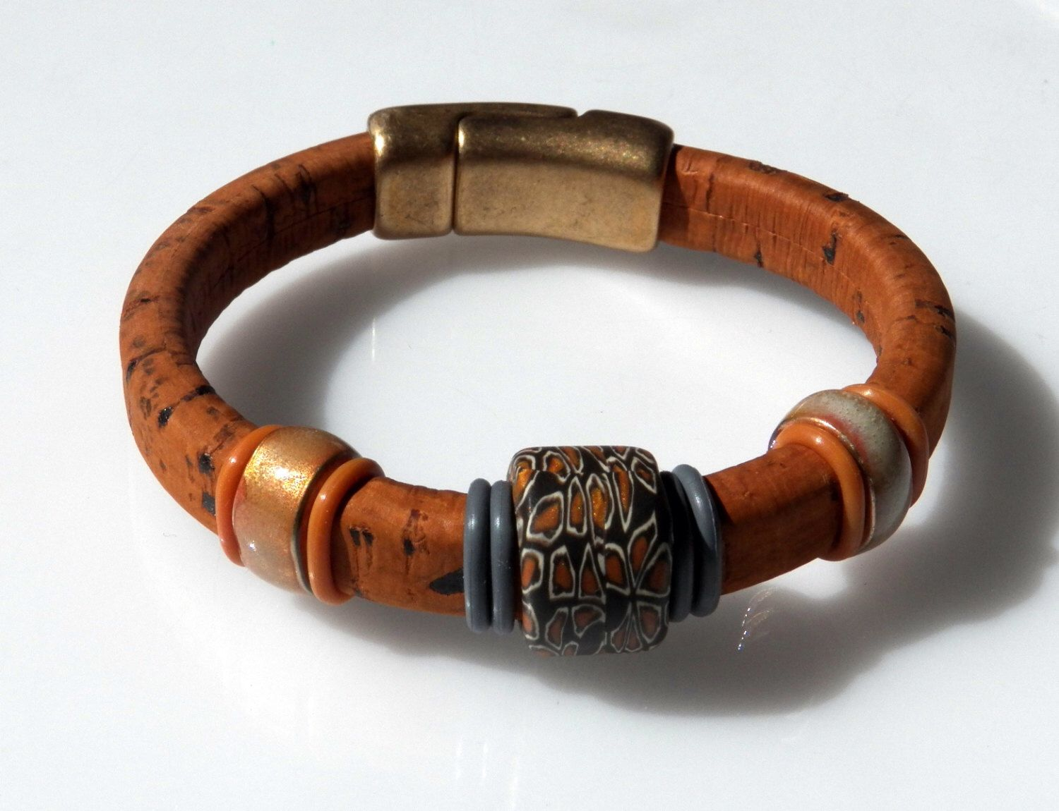 Terra Cotta Cork Bracelet with Enamel Beads, a Hand Made Samunnat Bead and a Brass Magnetic Clasp by KaleidoscopeBaubles on Etsy https://www.etsy.com/listing/197997234/terra-cotta-cork-bracelet-with-enamel