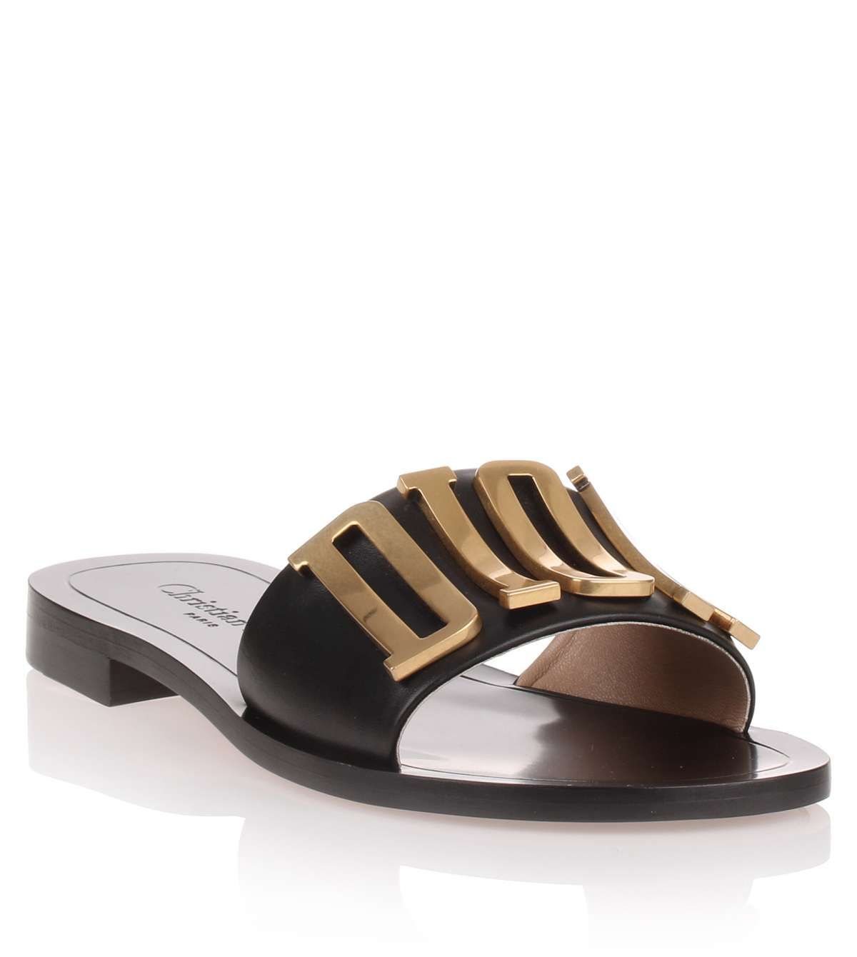 eabf16a2c7a Black leather slide sandal with  DIOR  logo detail from Dior. The  Diorevolution has an antique style brass  DIOR  logo on the toe and a slide  design.
