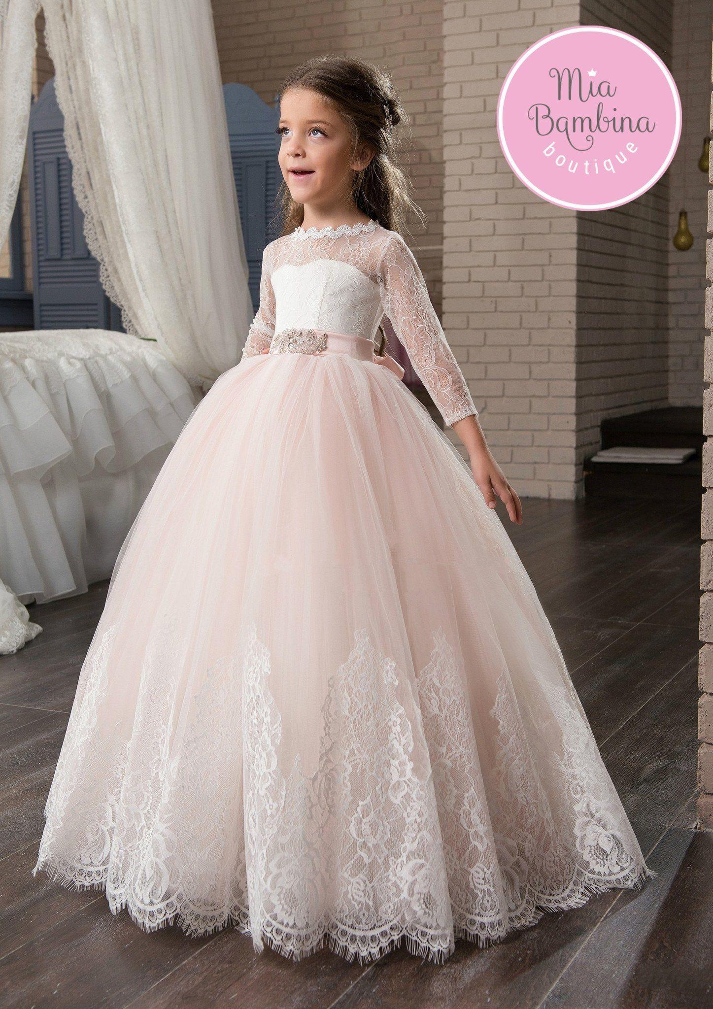 c1e56c7c0b7 The San Bernadino flower girl dress features a floor-length princess  silhouette