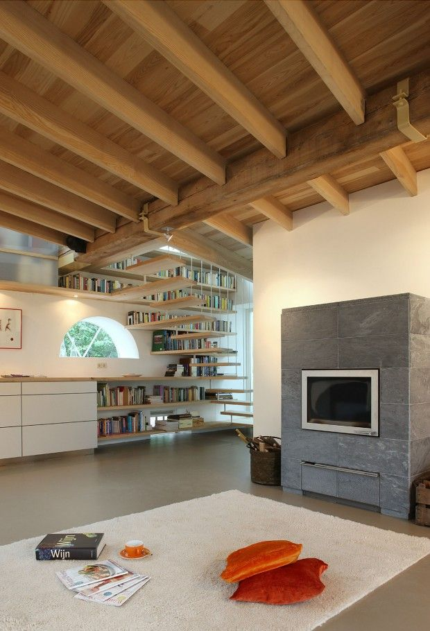 Concrete floor, cream walls and wood ceiling?  Add some white to roof as too heavy