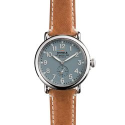Obsessed---The Runwell 41mm brown leather watch with blue face features a stainless steel case along with a Swiss quality quartz Argonite 1069 movement, which is hand-assembled in Detroit from nearly four-dozen Swiss made parts.