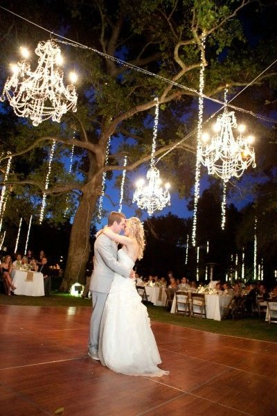 Outside wedding party (i like the floor on the grass.  lights are ugly ~Dahni)