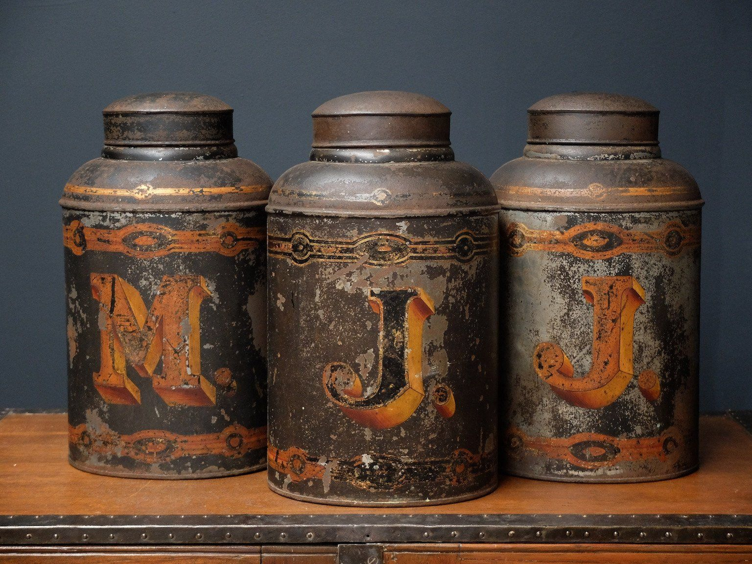 Three Toleware tea canisters.  English 1870s