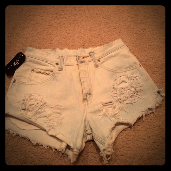 Vintage Wrangler cut off shorts These vintage wranglers were custom distressed by my gf unfortunately she lives a few states away and I was unable to try on and of course they are too big 😔 they come with her signature pearls and bow on front and back pockets! Roll em up or wear them long! If you like her design check her Instagram @27hangers Jeans