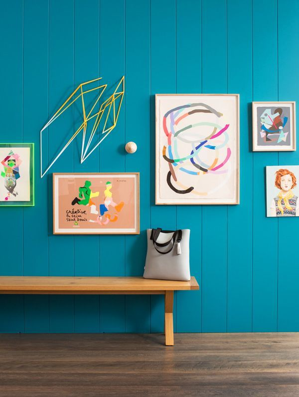 Bold choice of wall #colour with colourful framed prints. #inspiration