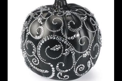 Halloween pumpkin painted black with sequin design. Must do this