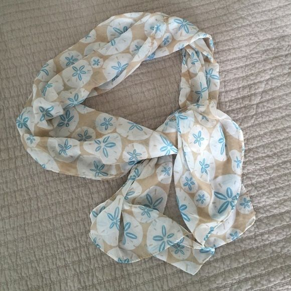 Sand Dollar Scarf Super cute and light sand dollar scarf. Really pops with a white shirt and jeans! Bought from a boutique on 5th Ave in Naples, FL. ☀️ Accessories Scarves & Wraps