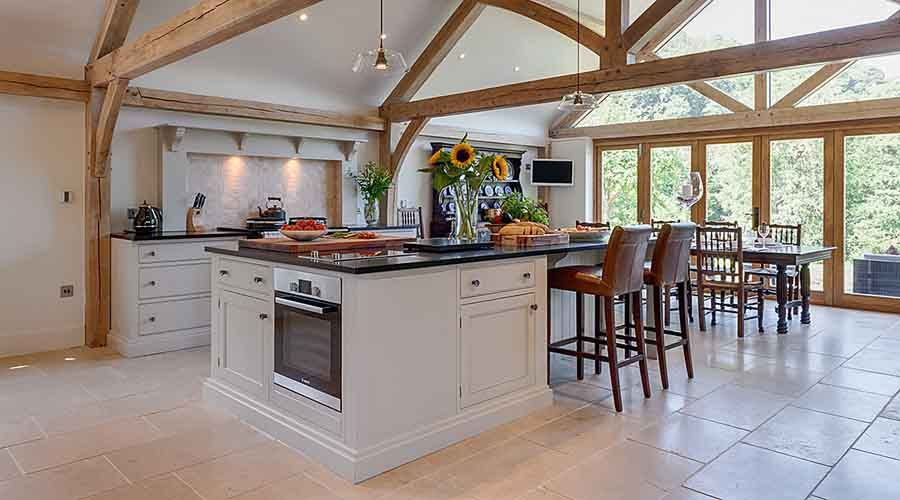 Country Kitchen Flooring a beautiful pale country style kitchen with beams and lloyd