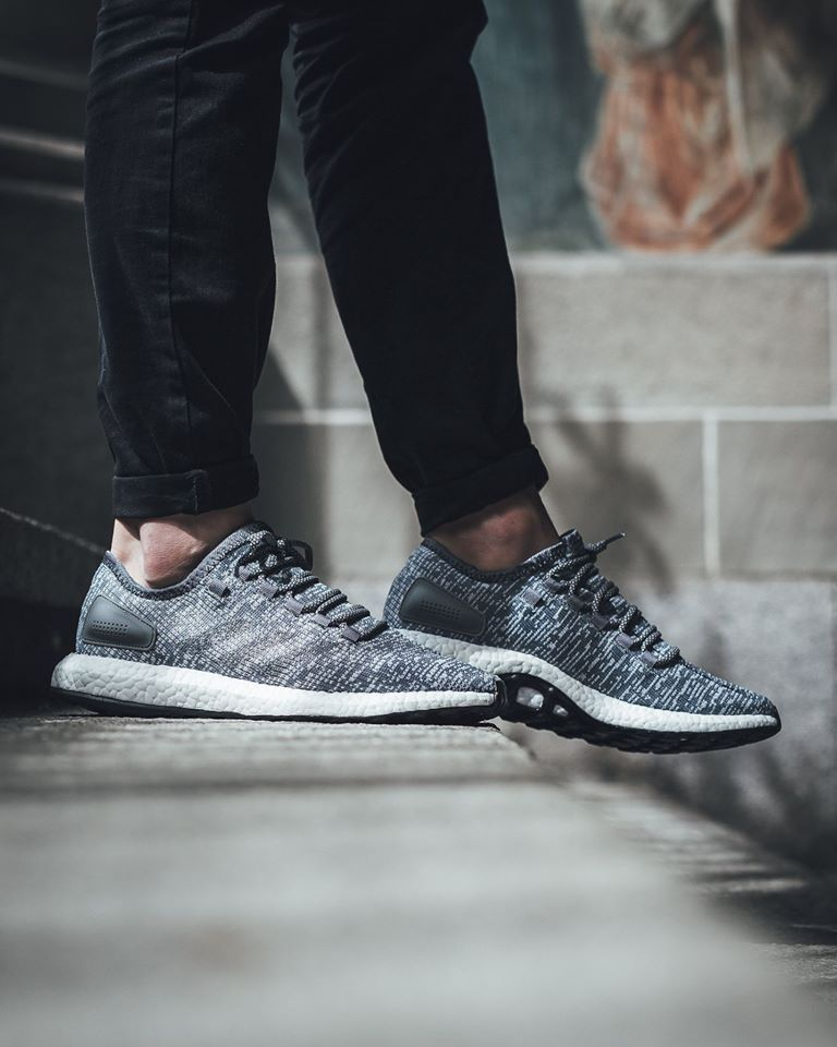 dfff6773e02 The adidas Pure Boost is featured in a brand new colorway of grey white.